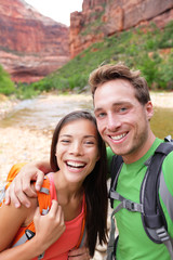 Happy couple taking selfie photo hiking