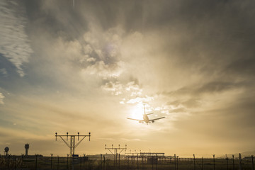 Airplane landing at dusk.