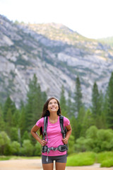 Hiking woman looking up at copy space in Yosemite