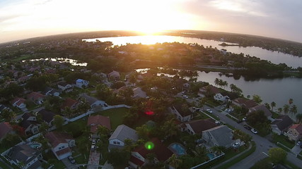 Sunset over suburnan homes aerial view