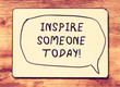 vintage board with the phrase inspire someone today! written on