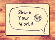 Vintage board with the phrase share your world written on it. re