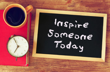 blackboard with the phrase inspire someone today