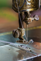 Old sewing machine and needle.