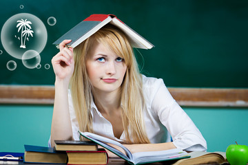 Daydreaming student, female teacher not paying attention