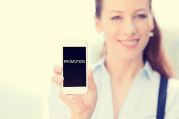 Businesswoman showing smart phone with promotion sign on screen
