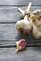 bunch of garlic on wooden surface