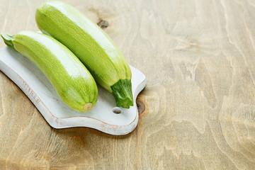 Two green zucchini on board