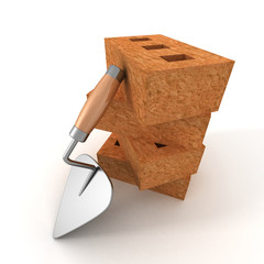 stack of bricks with a mortar trowel on white background