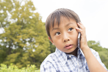Boy to call on a mobile phone