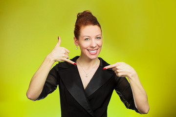 Woman making, showing call me hand gesture, sign