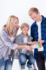 Family choosing a color for painting wall