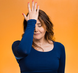Woman realizes mistake regrets, slapping hand on head duh