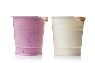 two plastic yogurt pots