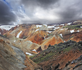 Multicolored mountains with snow
