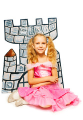 Girl in princess dress and her cardboard castle