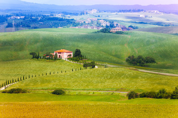Lonely house in Tuscany landscape, Italy