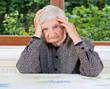 Unhappy elderly woman
