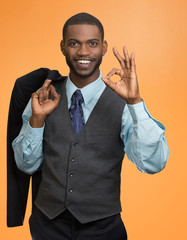 Cheerful young African man in full suit, showing Ok sign