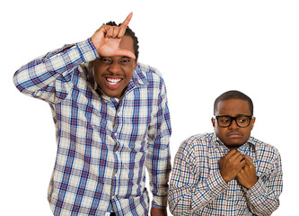 Two men, rude bully showing looser sign, shy little nerd guy