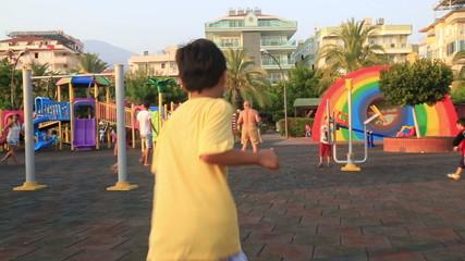 child smiling and running to playground