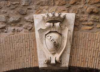Coat of arms on a gate in the wall around the Vatican. Rome, Ita