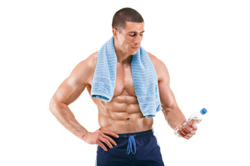 Healthy muscular man holding bottle of water. Naked torso