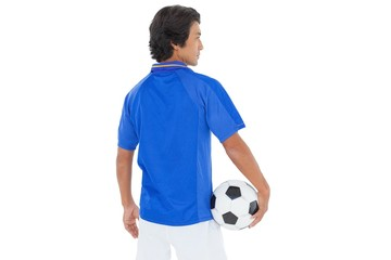 Rear view of a serious football player