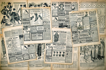 Newspaper pages with antique advertising
