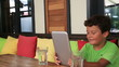 Child using digital tablet at the restaurant