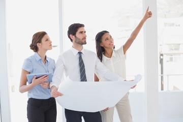 Business team reading a plan