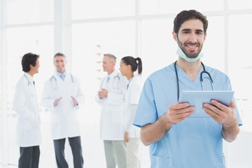 Smiling doctor with a tablet