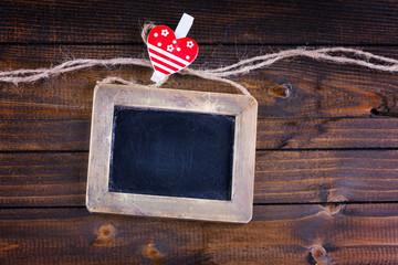 Empty blackboard  on wooden background.