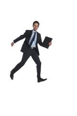 Geschäftsmann mit Aktentasche springt