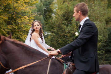 wedding couple on horses