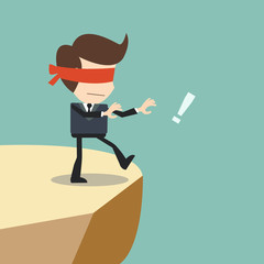 Concept of risk in business with blind businessman