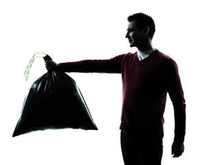 man dumping garbage bag
