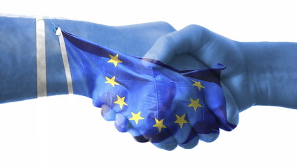 Flag of EU - European Union over a handshake.