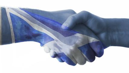 Flag of Scotland over a handshake.