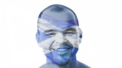 Flag of Scotland over a face of a young adult man.