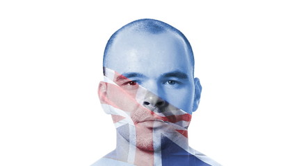 British flag over a face of a young adult man.