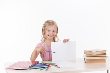little girl studying literature and smiling.