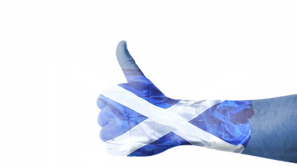 Flag of Scotland over hand showing thumbs up.