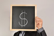 Businessman with dollar blackboard