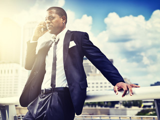 african man on smartphone in suit;