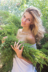 Sensual woman in coniferous forest