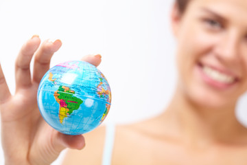 woman's hand with globe