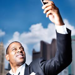 african businessman taking selfie