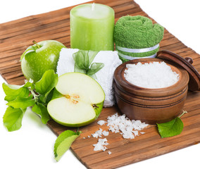 spa setting with green apple