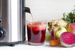 Juicer and juice with fresh fruits and vegetables - 70025697